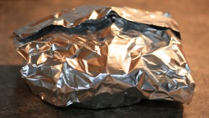 Wrap foil tightly around donut then wrap the second piece of foil around foil packet