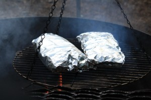 Place foil packs on grill or stove over medium heat for 12-15 minutes or until chicken is cooked through and potatoes are tender.