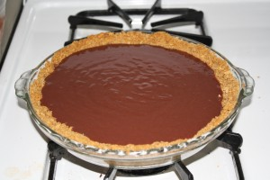 Mix pudding packet with 2 1/2 cups of milk. Whisk for 2 minutes. Pour pudding into pie shell and place in refrigerator for 45 minutes to set up.