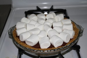 Turn on broiler. Arrange marshmallows in one even layer on top of pie filling.