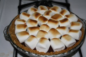 Place pie in oven under broiler to toast marshmallows. Watch VERY closely! It only takes a few seconds to go from white marshmallows to a scorched mess.