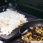 In a skillet or on a griddle, brown the hashbrowns. The secret to good hashbrowns is to leave them alone until they are ready to flip. Brown the sausage in another skillet. Add the corn and black beans until heated through.