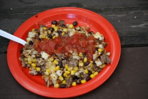 Add hash browns to the sausage, bean,corn mixture.  Put on a plate.  Add shredded cheese and salsa.