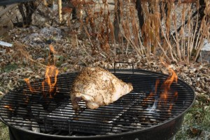 Set the grill up for indirect cooking.  Put a pile of coals on each side of the grill and place a foil pan between the piles.  Add a handful of wood chips to each pile of coals and place the turkey above the pan.  Cover with the vents open.