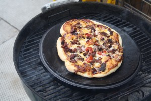 Place your pizza on the dutch oven lid.  Cover and cook until the crust is golden and the cheese is bubbly.